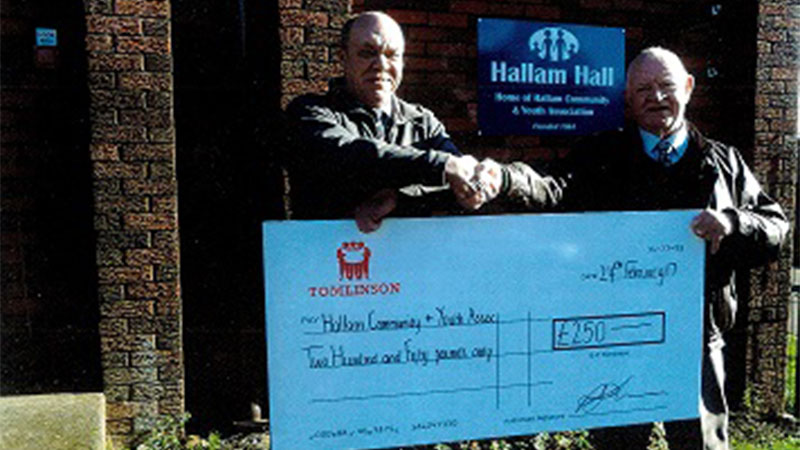 Tomlinson presenting a cheque to Hall Manager Alan Bone